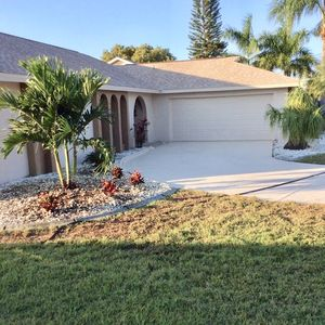 Photo for Sunny - Beautiful Waterfront home with heated pool and pet  friendly