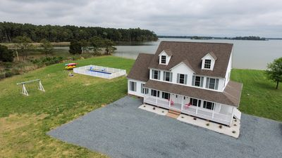Photo for Waterfront 5BR/3.5BA with private pool, dock, fire pit, kayaks, beach Sleeps 18