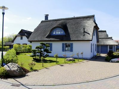 Photo for Romantic luxury thatch-roof house 300m to the beach, playground nearby, WiFi