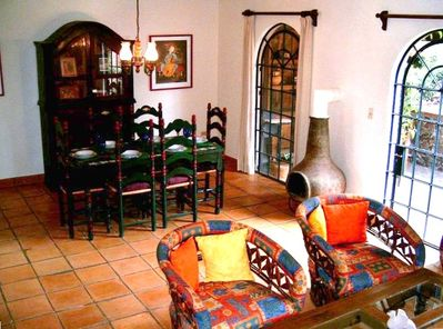 Inviting Areas to Relax in Living/ Dining Great Room with Arched Doors to Patio