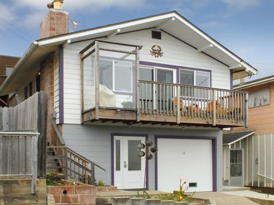 Photo for Comfortable Cottage located a block walk to the beach