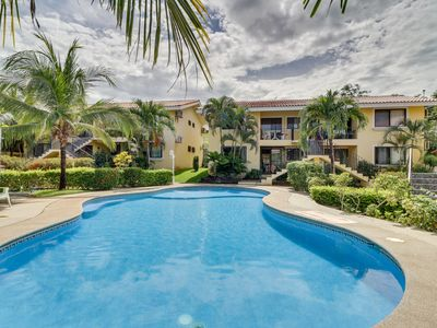 Photo for NEW LISTING! Ground-level condo w/shared pool, fitness room-walk to beach