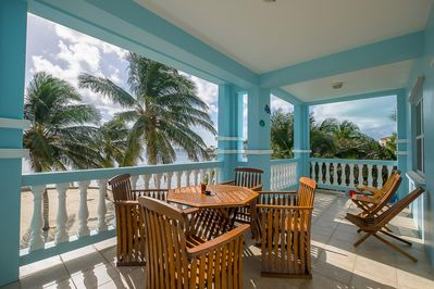 Gorgeous balcony looking right out at the beach! Have meals and cocktails here!