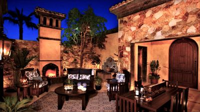 Outdoor living room has gas fireplace & fountains for soothing relaxation!
