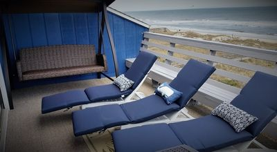 Spacious Oceanfront balcony with comfortable seating and patio swing!