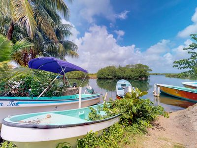 Photo for NEW LISTING! Lakefront home on Placencia Lagoon w/porch & kayaks-walk to beach