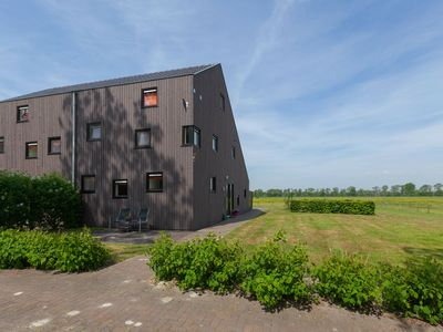 Photo for Luxury leisure home beside the forest and golf course and water sports Langweer