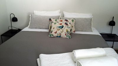 King Size bed in room 1 with bedside tables, quality linen and pocket spring bed