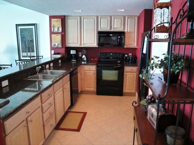 Kitchen with cutom tiling and granite counters