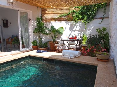 Photo for El Patio de Lola, an Andalusian village house with green marble splash pool.