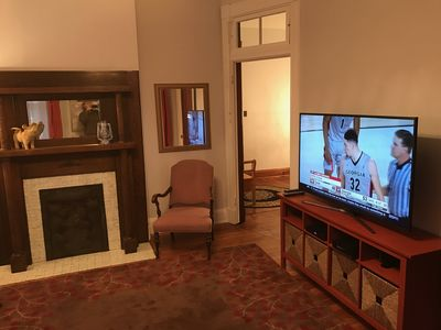 """Living room with fireplace and 55"""" 4K HDTV with HD cable and wi-fi"""