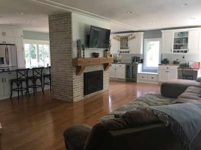 fireplace, living room, and view toward the kitchen