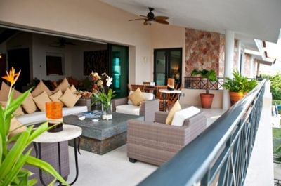 outdoor veranda and dining area with views of  the beachclub and Bay of Banderas