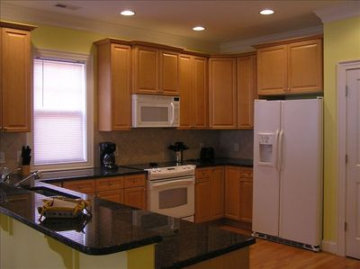 Spacious Kitchen with granite counter tops