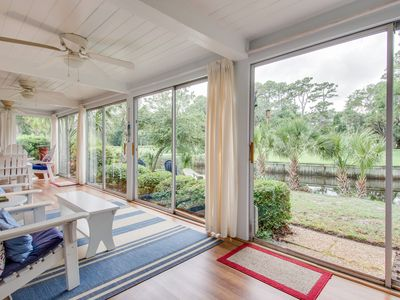Photo for Updated, waterfront condo w/ amazing lagoon & golf views from the sun room