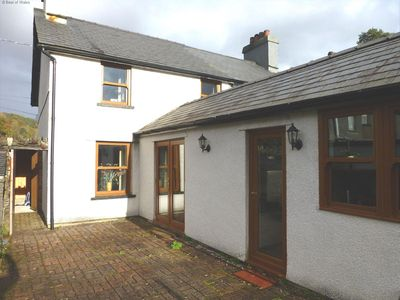 Photo for This traditional miner's cottage in Dolwyddelan has been carefully modernised to provide cosy yet