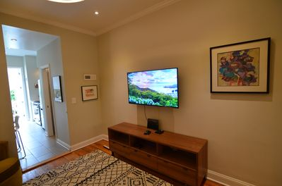 Living area with Comcast Full Cable subscription.
