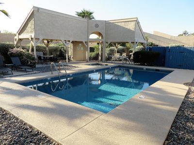 Newly renovated community pool with heated spa.