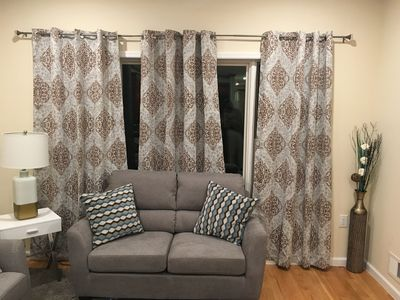LoveSeat in front of large living room window