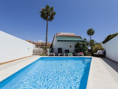 Photo for Detached villa with private heated pool, garden, terrace, 50m to the sea, Wifi