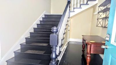 Entering your foyer & heading upstairs