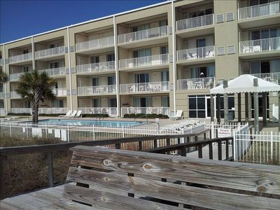Photo for Beautiful Bottom Floor Unit - Beachfront view just steps from the pool