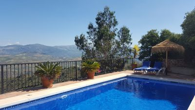 Private pool with excellent views, sunbeds and sun umbrellas