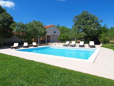 Photo for This 3-bedroom villa for up to 7 guests is located in Biograd / Biograd Na Moru and has a private sw