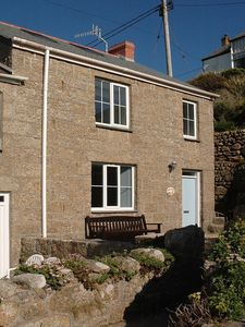 Photo for Family seaside cottage with fantastic sea views just 1 minute from the beach