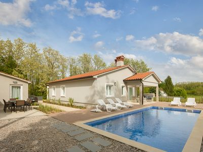 Photo for Brand new villa features a garden, pool and view on a nearby vineyard