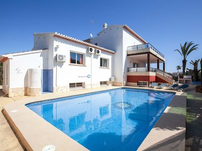 Photo for 6 bedrooms, games room with pool table, table tennis + football table, A/C throughout, outskirts of Javea.