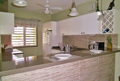 Completely renovated kitchen, with bar seating for four.