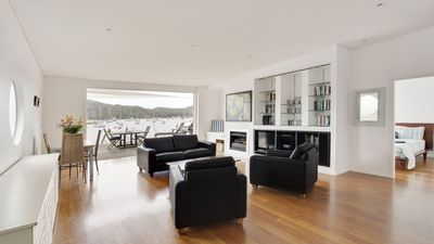 Large open plan living extends onto waterfront deck