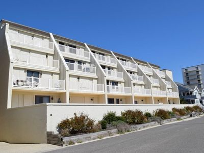 Photo for Awesome Beach Front Condo -  North end corner unit with huge deck overlooking the beach.