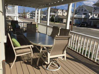 spacious deck with table and loungers
