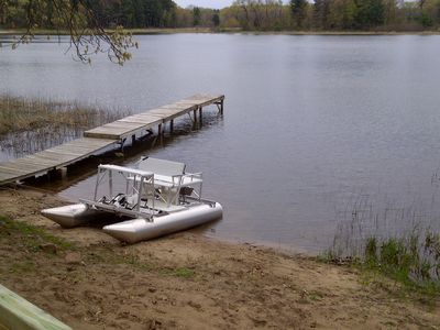 Photo for Quiet lakeside cabin, steps from sandy beach, beautiful views to relax, enjoy