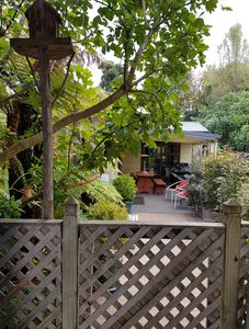 Entrance through gate from carport