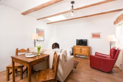 Traditional kiva fireplace offers the warmth and smell of NM pinon firewood.