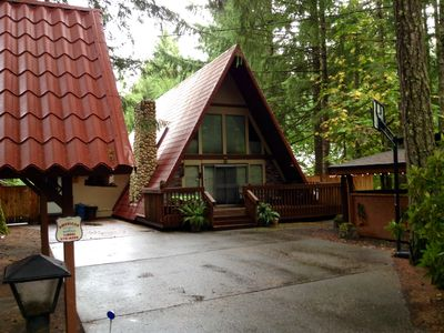 Beautiful cabin situated on large lot with covered gazebo and private hot tub.