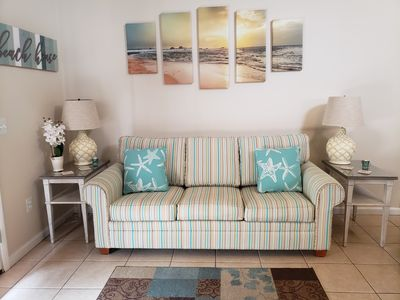 Photo for Beautiful 2bd/2bath condo. Park next to your own private patio. Steps from beach