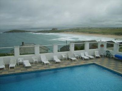 Photo for NEWQUAY - FISTRAL BEACH -STUNNING SEA VIEWS- SWIMMING POOL-GARDENS-MODERN HOUSE