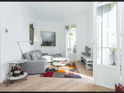Photo for Art-filled, bright, cozy duplex in the heart of Carré d'Or