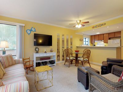 Photo for Shared pools, hot tub, & sauna, one block from the beach - snowbird friendly