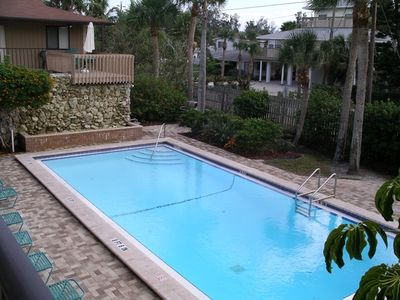 Unit overlooks one of the two heated pools - with waterfall