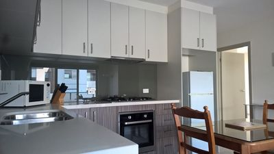 Fully-equipped kitchen with open plan dining and lounge