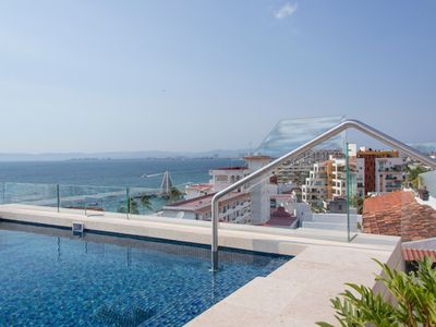 Photo for Luxury 1 Bedroom Condo Walking distance to the Beach!