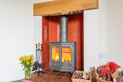 You'll be warm enjoy the wood burning stove. wood included.