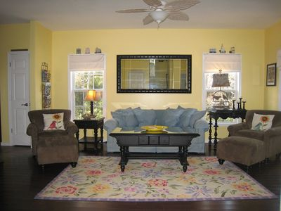 Bright and cheery main level family rm with seating for 6 plus misc stools.