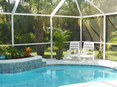 Plenty of room to sit back in the sun or swim in the screen enclosed pool