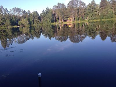 Secluded lake cabin on 2 acres with sandy swimming beach, dock and sauna